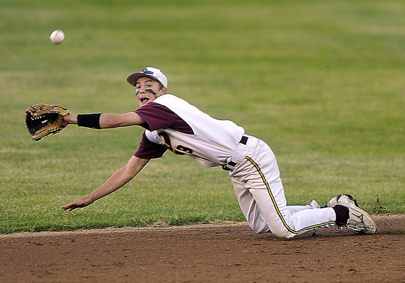 Cape Elizabeth second baseman Matty Pierce dives to spear a line drive in the seventh inning Thursday against Falmouth. The catch preserved pitcher Sam Kozlowski's no-hitter, but Falmouth got an unearned run in the eighth inning and captured the Western Class B title with a 1-0 victory.