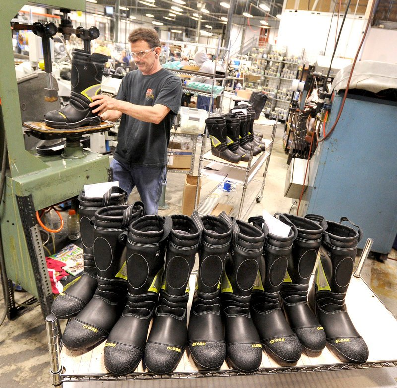 Rick Nedeau prepares boots to be soled at Falcon Performance Footwear in Auburn.