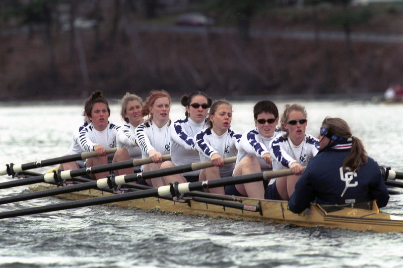 Julia Pitney (then Julia Greenleaf), fourth from back, rows with the Connecticut College women's crew team in April 1999. That fall, after their coach stepped down and was replaced by one with little experience, the team staged a sit-in.