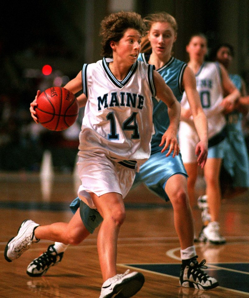 UMO's Cindy Blodgett drives to the basket in 1996, showing why children at the time wore her No. 14 replica jersey.