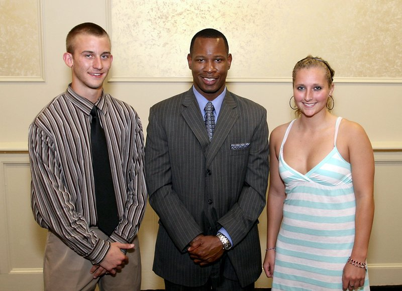 Nate Doehler, left, and Stephanie Whitten, 2009 Portland Press Herald/Maine Sunday Telegram Athletes of the Year, share the moment with guest speaker Wil Smith at the 2009 award ceremony.