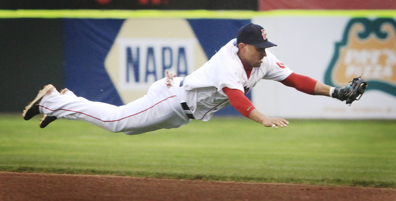 Second baseman Ryan Dent of the Portland Sea Dogs stretches to knock down a grounder in the third inning Tuesday night, but doesn't make the throw to first during a 5-3 loss to New Hampshire in 13 innings at Hadlock Field.