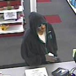 A man in his mid-20s to mid-30s with short brown hair and wearing white-rimmed sunglasses robbed the Community Pharmacy in Saco shortly before 4 p.m. today.