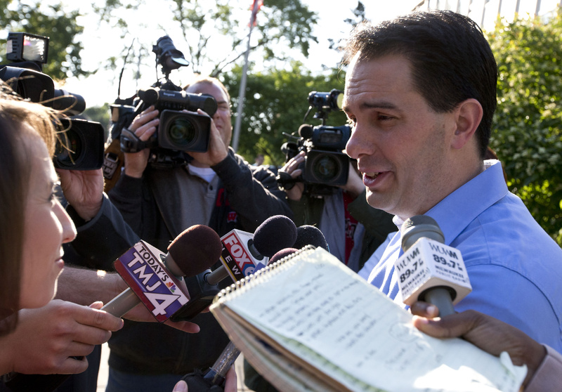 Wisconsin Republican Gov. Scott Walker talks to reporters after voting Tuesday in Wauwatosa, Wis. Walker survived the recall.