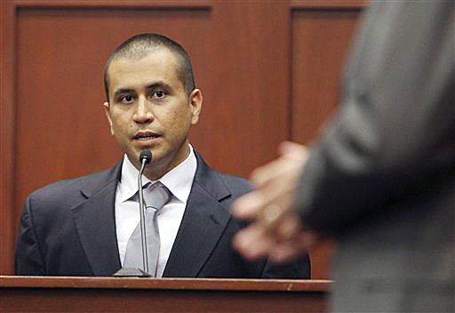 George Zimmerman, left, answers a question from attorney Mark O'Mara during a bond hearing in Sanford, Fla., in this April 20, 2012, photo,