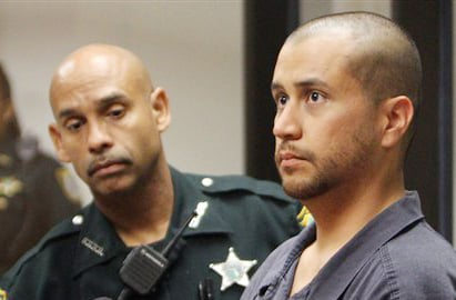 George Zimmerman, right, charged with killing 17-year-old Trayvon Martin, stands next to a Seminole County Deputy during a court hearing in Sanford, Fla., in this April 12, 2012, photo,