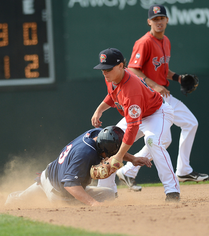 John Tolisano of the Fisher Cats beats the tag by Portland's Zach Gentile to steal second in Sunday's game at Hadlock Field. New Hampshire won the final game of the five-game series, 5-1.
