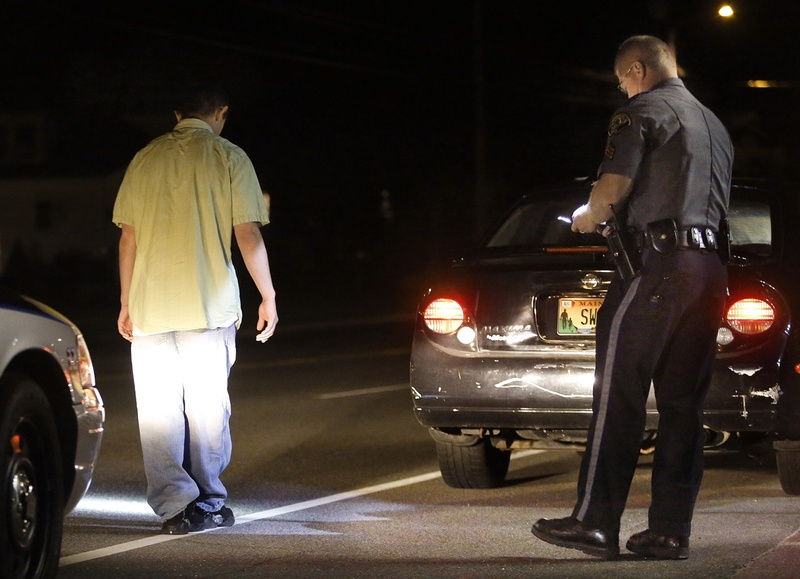 Scarborough police Sgt. Tom Chard conducts a sobriety test Thursday after stopping a motorist during an operating-under-the-influence detail on Route 1. The driver passed the test. Average conviction rates on OUI charges range from 37 percent in York County to 83 percent in Hancock and Penobscot counties.