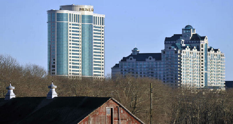 In this March 2012 file photo, Foxwoods Resorts Casino and MGM Grand at Foxwoods loom behind a barn in Mashantucket, Conn.