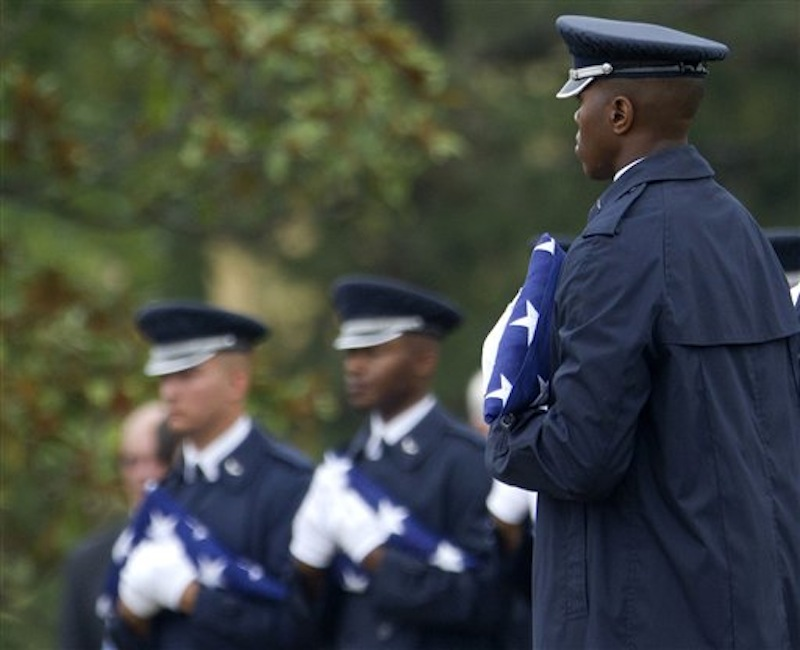 Members of the Air Force Honor Guard hold American flags to be presented to family members during a burial service for Air Force Col. Joseph Christiano, Col. Derrell B. Jeffords, Lt. Col. Dennis L. Eilers, Chieft Master Sgt. William K. Colwell, Chief Master Sgt. Arden K. Hassenger and Chief Master Sgt. Larry C. Thornton, Monday, July 9, 2012, at Arlington National Cemetery Arlington, Va. It was Christmas Eve 1965 when the Air Force plane nicknamed