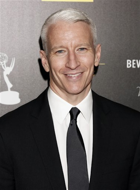 This June 23, 2012 file photo shows CNN's Anderson Cooper arrives at the 39th Annual Daytime Emmy Awards at the Beverly Hilton Hotel in Beverly Hills, Calif. Cooper came out in a letter online, saying