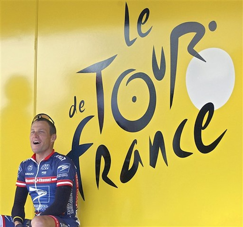 In this July 5, 2004, file photo, US Postal Service team leader and then a five-time Tour de France winner Lance Armstrong, of Austin, Texas, sits by the registration bus prior to the second stage of the 91st Tour de France cycling race. The U.S. Anti-Doping Agency is bringing doping charges against the seven-time Tour de France winner, questioning how he achieved those famous cycling victories. Armstrong, who retired from cycling last year, could face a lifetime ban from the sport if he is found to have used performance-enhancing drugs. He maintained his innocence, saying: