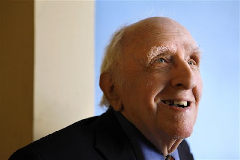 In this June 1, 2009 file photo, Frank Kameny is seen in his home in Washington. A Canadian amateur astronomer who discovered several asteroids has named one after U.S. gay rights pioneer Frank Kameny who died last year in Washington. Kameny, who earned a doctorate in astronomy at Harvard University, was an astronomer with the U.S. Army Map Service in the 1950s but was fired from his job for being gay. He contested the firing all the way to the Supreme Court and later organized the first gay rights protests outside the White House, the Pentagon and in Philadelphia in the 1960s. Kameny died last year at age 86. (AP Photo/Jacquelyn Martin, File)