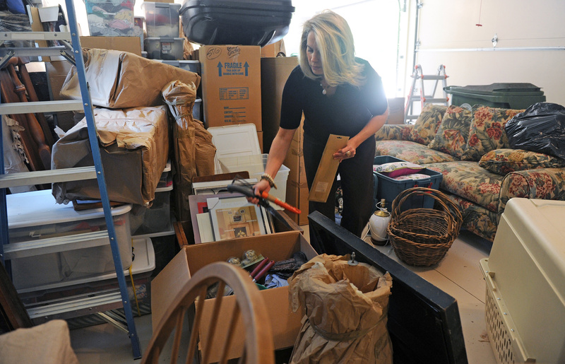 Certified professional organizer Sara Fisher goes through items brought over from a storage space at a client's home in Atlanta, Ga. The trend of offering services to people who can't or don't want to do them is growing. 04000000 FIN krtbusiness business krtnational national krtedonly cdm mct 04006000 krtfinancialservice financial services krtnamer north america krtusbusiness u.s. us united states 2012 krt2012