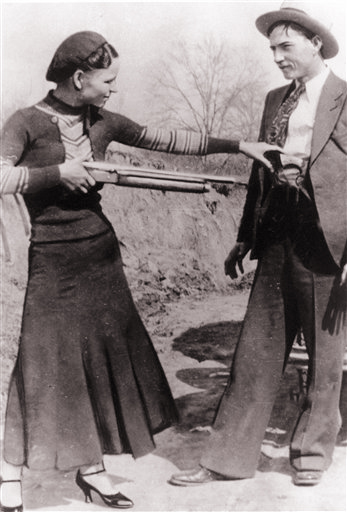 This undated photo shows outlaws and lovers Bonnie Parker and Clyde Barrow engaging in a little playful banter.