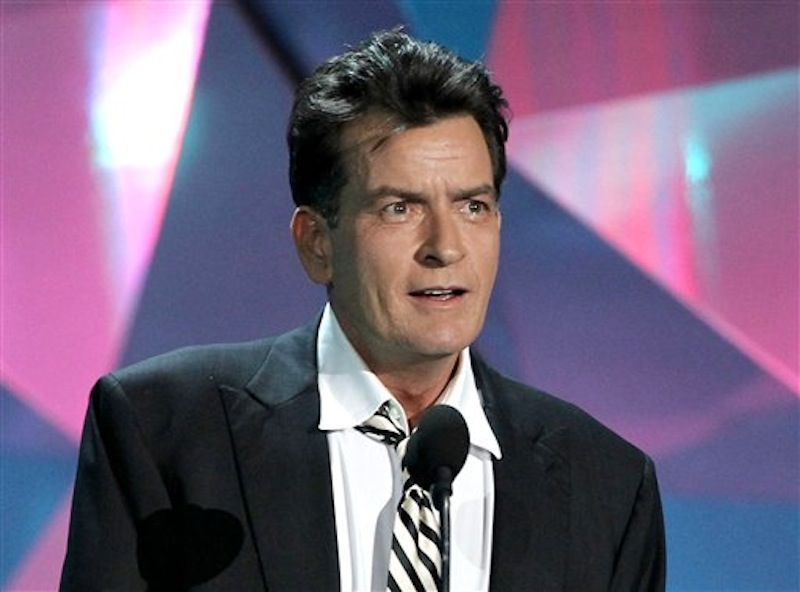 This June 3, 2012 file photo shows actor Charlie Sheen at the MTV Movie Awards in Los Angeles. In an interview Tuesday, July 17, on Ryan Seacrest's radio show, Sheen said ìAmerican Idolî producer Nigel Lythgoe publicly threw his name out there as a possible judge and the idea peaked his interest. Sheen told Jay Leno Monday night on ìThe Tonight Showî that his two demands would be that FX and his ìAnger Managementî team ìwould have to be into itî and there would need to be a charitable component to him taking the job. (Photo by Matt Sayles/Invision/AP, file)