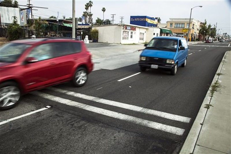 Traffic moves along the crossing where the U.S. Commerce Department Secretary John Bryson suffered a traffic accident last Saturday in San Gabriel, Calif., Monday, June 11, 2012. Bryson won't be charged, the district attorney's office said Tuesday, July 3, 2012. (AP Photo/Damian Dovarganes)