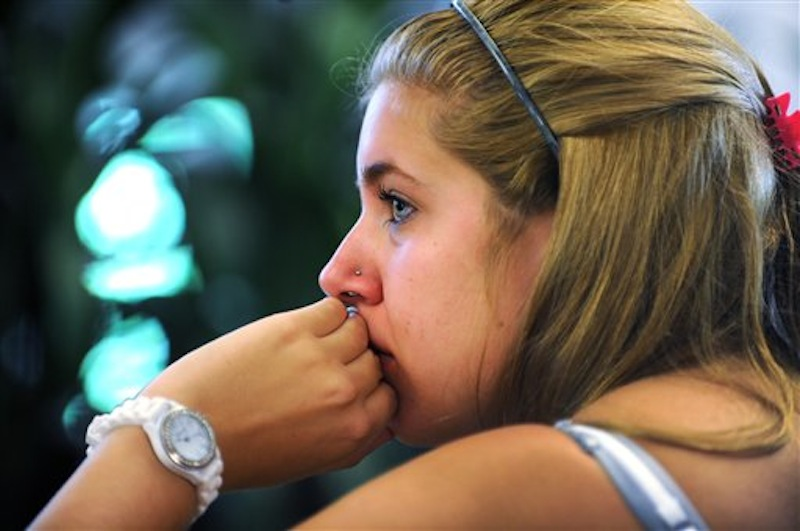 Penn State student Jessica Knoll begins to cry as she watches the televised news conference held by former FBI director Louis Freeh after the release of his report on the Jerry Sandusky child sex abuse scandal in the HUB building on the main campus in State College, Pa., Thursday, July 12, 2012. Freeh's investigation found that senior Penn State officials, including Hall of Fame football coach Joe Paterno,