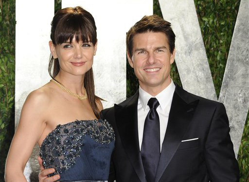Actors Tom Cruise and Katie Holmes arrive at the Vanity Fair Oscar party, in West Hollywood, Calif., in February.