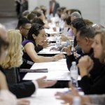 Job seekers have their resumes reviewed at a job fair expo in Anaheim, Calif., on June 13. U.S. employers added only 80,000 jobs in June, a third straight month of weak hiring that shows the economy is still struggling.