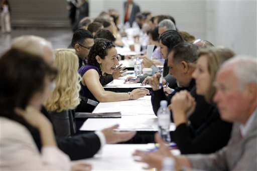 Job seekers have their resumes reviewed at a job fair expo in Anaheim, Calif., recently. The June unemployment rate was unchanged at 8.2 percent, the Labor Department said today.