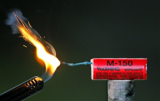 In this photo made Friday, June 22, 2012, an M-150 firework is lit in Freeport, Maine. South Portland says is cracking down onillegal use of fireworks within its city limits. (AP Photo / Robert Buktay)