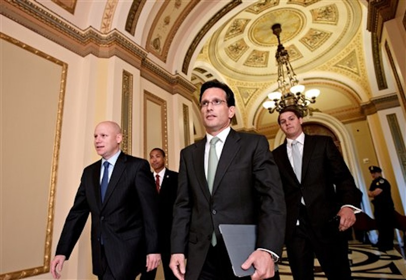 House Majority Leader Eric Cantor of Va., walks from the House floor as he manages the vote to repeal the Affordable Care Act which he sponsored, Wednesday, July 11, 2012, on Capitol Hill in Washington. (AP Photo/J. Scott Applewhite)