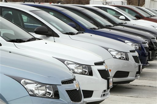 A line of 2012 Chevrolet Cruze sedans on display at a dealership in the south Denver suburb of Englewood, Colo.