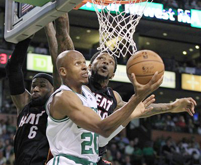 Former Boston Celtics guard Ray Allen drives past Miami Heat forward LeBron James and forward Udonis Haslem during Game 3 of the NBA playoffs Eastern Conference finals in Boston on June 1, 2012.