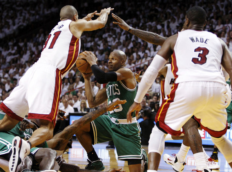 In this June 5 file photo, Ray Allen of the Boston Celtics looks to pass the ball as Miami Heat's Shane Battier (31) and Dwyane Wade (3) defend. Allen told the Heat tonight that he has decided to leave the Celtics and join the reigning NBA champions.