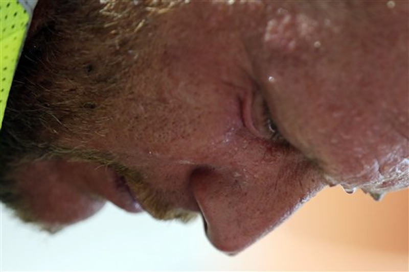 Perspiration collects on construction worker David Macmullen's face in the afternoon heat, Friday, July 6, 2012, in Philadelphia. The National Weather Service said the record-breaking heat that has baked the nation's midsection for several days was slowly moving into the mid-Atlantic states and Northeast. Excessive-heat warnings remained in place Friday for all of Iowa, Indiana and Illinois as well as much of Wisconsin, Michigan, Missouri, Ohio and Kentucky. (AP Photo/Matt Rourke)