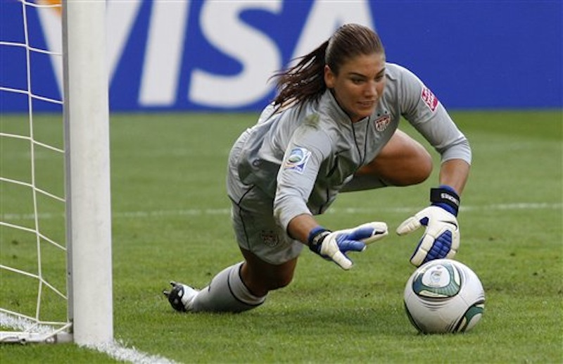 In this July 10, 2011, file photo, United States goalkeeper Hope Solo catches a ball during the quarterfinal match against Brazil at the Women's Soccer World Cup in Dresden, Germany. Solo received a public warning Monday, July 9, 2012, from the U.S. Anti-Doping Agency after she tested positive for the banned substance Canrenone in a urine test. Solo has accepted the warning and will still play for the United States in the Olympic tournament. (AP Photo/Petr David Josek, File)