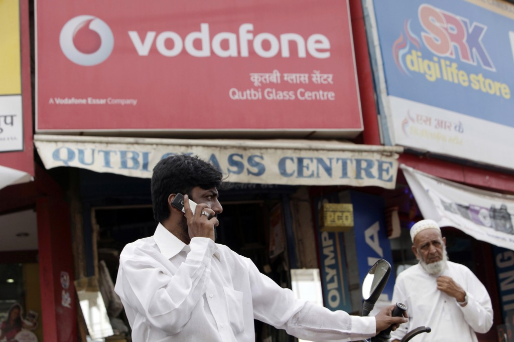 Indian wireless carriers are offering money transfer services in a nation where mobile phone connections outnumber bank accounts.