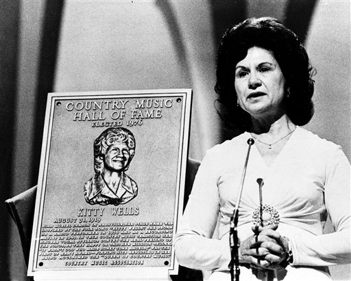 This 1976 file photo shows Country Music Hall of Fame inductee Kitty Wells during the Country Music Association (CMA) awards in Nashville, Tenn. Wells, the first female superstar of country music, has died at the age of 92. The singer's family says Wells died at her home Monday after complications from a stroke. Her recording of