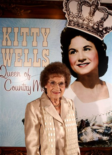 This Aug. 14, 2008 file photo originally released by the Country Music Hall of Fame and Museum shows music pioneer Kitty Wells at an exhibit honoring her career in Nashville, Tenn. Wells, the first female superstar of country music, has died at the age of 92. The singer's family says Wells died at her home Monday after complications from a stroke. Her recording of