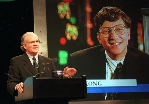 In this Dec. 14, 1995, file photo, Robert Wright, president and CEO of NBC, speaks in New York as Microsoft Chairman Bill Gates, displayed on screen, speaks from Hong Kong, during the announcement of the launch of MSNBC, a cable news channel and related online service. Microsoft is pulling out of the joint venture that owned MSNBC.com. The breakup, announced late today, dissolves the final shred of a 16-year marriage between Microsoft Corp. and NBC News, which is now owned by Comcast Corp.