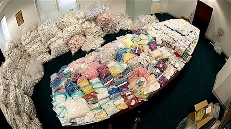 In this undated photo provided by the Federal Bureau of Investigation, a large supply of vials, pills and other medical supplies seized by the FBI in a drug diversion scheme are shown in the FBIís evidence room in New York. Prosecutors say that the scheme cheated Medicaid out of hundreds of millions of dollars by buying mountains of HIV medications and other drugs from down-and-out Medicaid recipients in New York City, then marketing the pills to pharmacies that dispensed them to unsuspecting consumers, authorities said Tuesday, July 17, 2012. (AP Photo/FBI, Matthew Coleman)