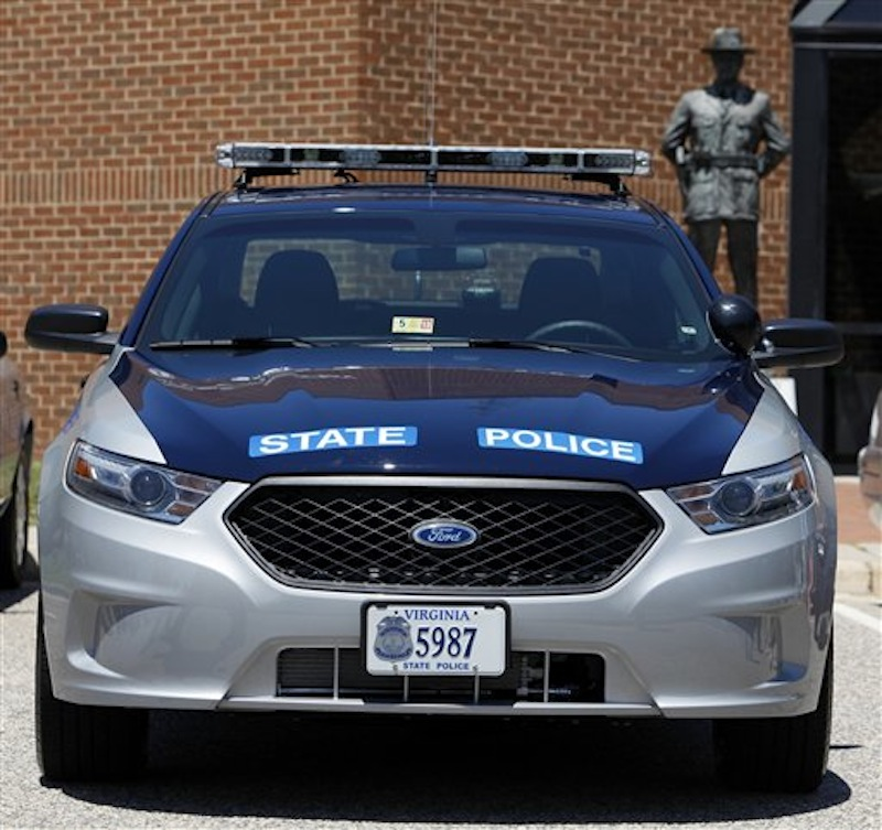 One of the new Ford Taurus police cruisers that will replace the Crown Victoria models sits at Virginia State Police headquarters Friday, June 15, 2012. (AP Photo/Richmond Times-Dispatch, Bob Brown)