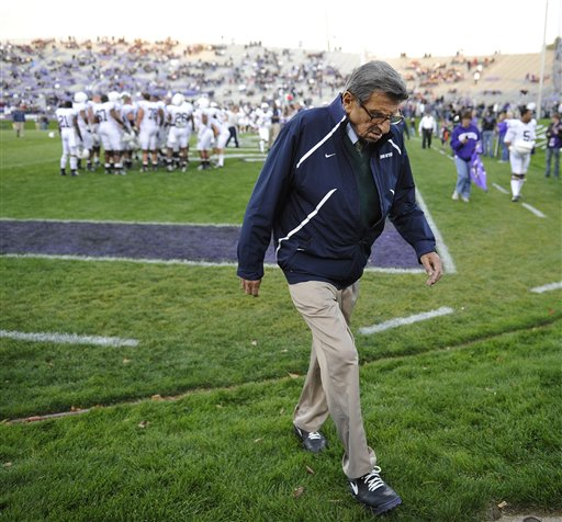 Penn State coach Joe Paterno walks off the field after warmups before Penn State's game against Northwestern in Evanston, Ill., in this Oct. 22, 2011, photo.
