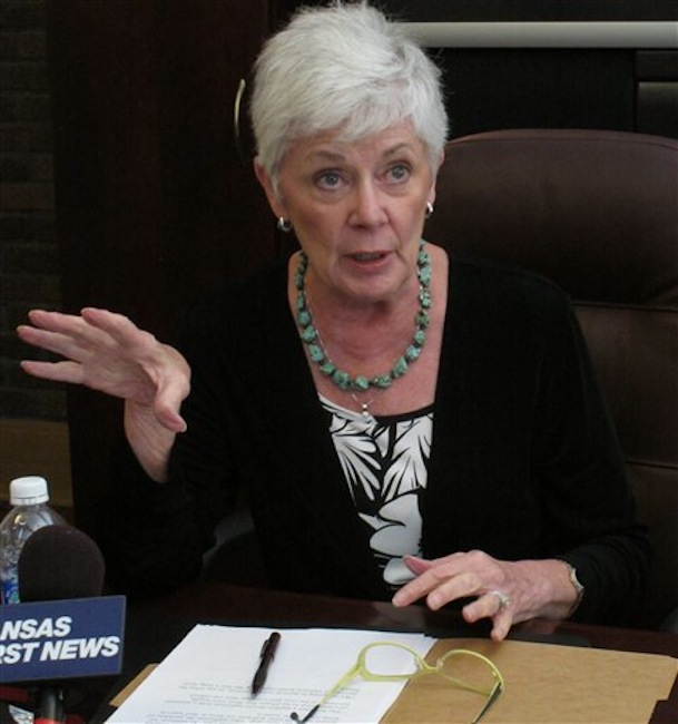 This photo from Thursday, June 28 2012, shows Kansas Insurance Commissioner Sandy Praeger answering questions from reporters in Topeka, Kan., about the federal health care overhaul upheld by the U.S. Supreme Court. Praeger acknowledges that her opinion of the federal law is far more favorable than that of most Kansas Republicans. (AP Photo/John Hanna)