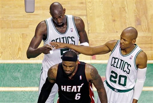 Boston Celtics guard Ray Allen, right, walks behind Miami Heat forward LeBron James in Game 4 of Eastern Conference finals in June. Allen will visit the Heat on Thursday to explore possibly signing with the team. (AP Photo/Charles Krupa)