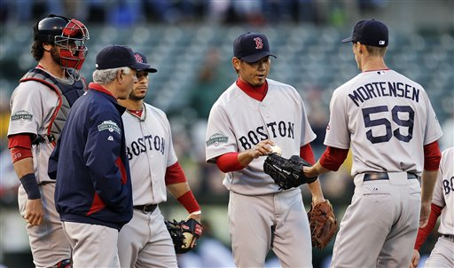Boston's Daisuke Matsuzaka, center, gives the ball to pitcher Clayton Mortensen after being removed from Monday's match against the Oakland A's in San Francisco.