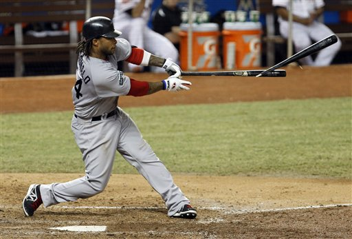 Darnell McDonald breaks his bat on a base hit in a June 12, 2012, game the Miami Marlins. The Red Sox won 2-1.