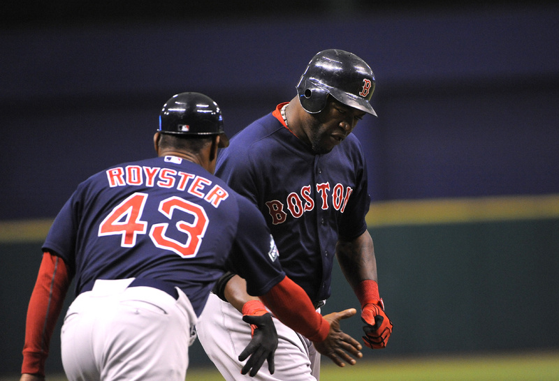 David Ortiz slaps hands with third base coach Jerry Royster as he rounds the bases after hitting a solo home run in the first inning against the Tampa Bay Rays Friday night in St. Petersburg, Fla.