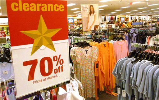 Shirts and blouse hang on racks at a clothing store in North Andover, Mass, recently. American shoppers, worried about jobs and the overall economy, pulled back on spending in June, resulting in tepid sales for many retailers. The results raise concerns about Americans' ability to spend during the back-to-school season, which is the second-biggest shopping period of the year and starts later this month.