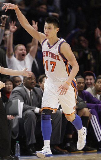 The New York Knicks' Jeremy Lin reacts after making a 3-point basket during the second half of an NBA basketball game against the Los Angeles Lakers on Feb. 10 in New York. He averaged 14.6 points and 6.2 assists in 35 games before his season ended because of torn cartilage in his left knee.