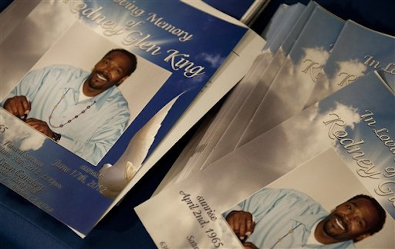 Stacks of programs for Rodney King's public memorial service lie in the Hall of Liberty at Forest Lawn-Hollywood Hills in Los Angeles on Saturday, June 30, 2012. King passed away earlier this month at 47. (AP Photo/Grant Hindsley)