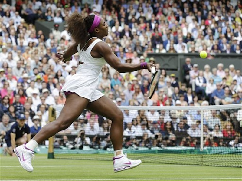Serena Williams of the United States plays a shot against Agnieszka Radwanska of Poland during the women's final match at the All England Lawn Tennis Championships at Wimbledon, England, Saturday, July 7, 2012. (AP Photo/Alastair Grant)