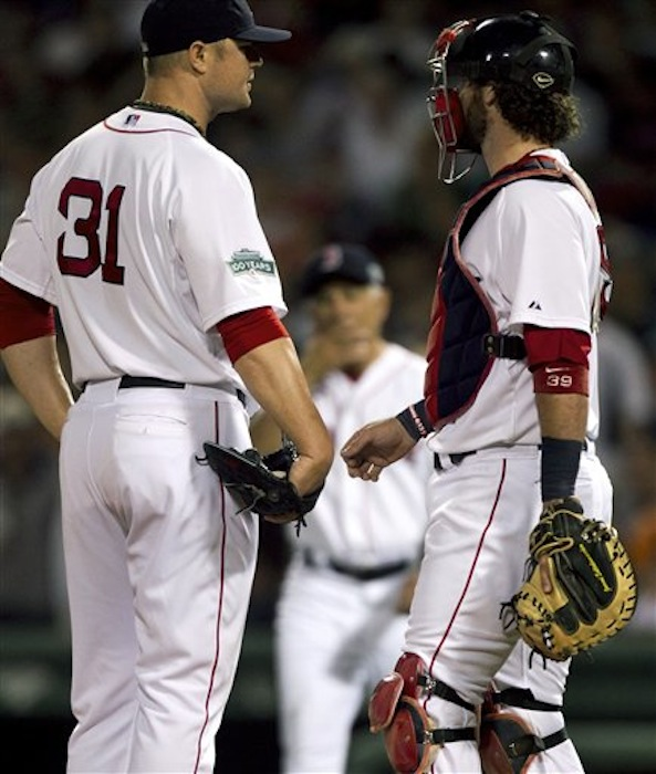 Boston Red Sox pitcher Jon Lester, left, talks with his catcher as manager Bobby Valentine, center, approaches the mound to relieve Lester from the game in the fifth inning Sunday against the New York Yankees. The last-place Red Sox are hoping for better health in second half of the season. (AP Photo/Steven Senne)