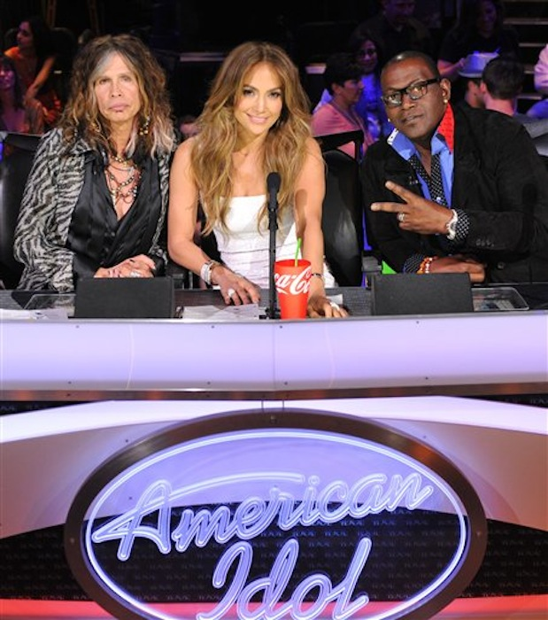 In this Feb. 28, 2012 photo released by Fox, judges, from left, Steven Tyler, Jennifer Lopez and Randy Jackson are shown on the set of the singing competition series,